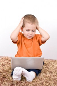 Frustrated child with computer