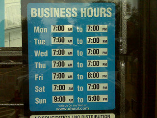 Business Hours from store window