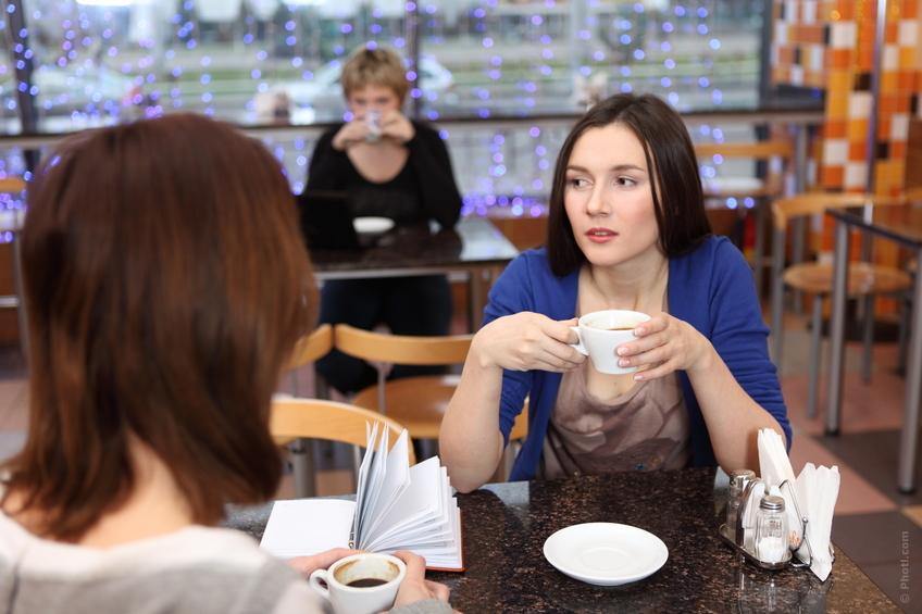 two girls having coffee