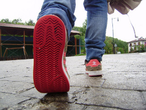 Red sole shoes walking