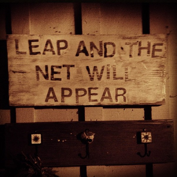 "Sign reading ""Leap and the net will appear"""
